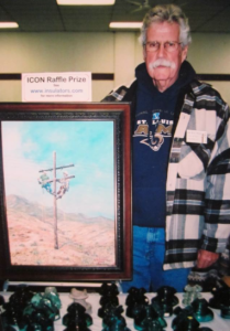 Alan Rigler donating one of his paintings to the N.I.A in 2006